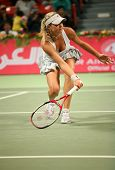 Maria Kirilenko of Russia in action against Martina Hingis in the Qatar Total Open, February 28, 200