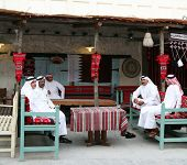 Qatari Arab nationals relaxing at a traditional coffee shop in the Old Souq, Doha, Qatar. The Qatari