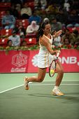 Serb tennis star Jelena Jankovic in action against Justin Henin in the Qatar Total Open, in Doha, Ma