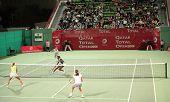 Elena Likhovtseva and Vera Dushevina (foreground) playing doubles against Venus Williams and Caroline Wozniacki in Doha, Qatar, February 2008