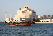 A traditional Arab dhow, of a kind still commonly used in the Arabian/Persian Gulf, anchored in front of the new Museum of Islamic Art in Doha, Qatar, September 2009