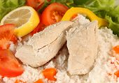 Boiled chicken and rice with salad vegetables, a meal suitable for a strict low-fat diet or for medi