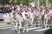 DOHA, QATAR - December 18:  Qatari mounted guardsmen in traditional attire take part in the National