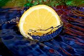 stock photo of crown green bowls  - Splash with fresh mandarin - JPG
