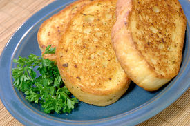 pic of french toast  - Three slices of Texas toast on a small blue ceramic plate - JPG