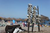 stock photo of gril  - Sardines on the grill in a seafood beach restaurant - JPG