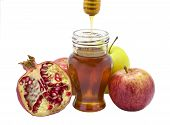 apple,honey and pomegranate isolated on white background
