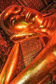 stock photo of budha  - Statue of reclining budha wat pho bangkok thailand - JPG
