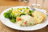 pic of lasagna  - A plate of vegetable lasagna with salad and garlic toast - JPG
