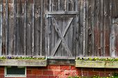 close-up barn door with potted plants