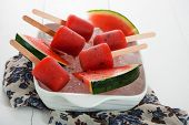 stock photo of popsicle  - watermelon popsicle in a white bowl with ice and fresch watermelon - JPG