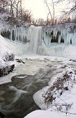 Frozen Waterfall At Sunset