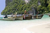 Wooden Longboats On The Beach