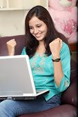 Excited Young Woman With Laptop