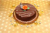 Chocolate Cake On Golden Stars Background