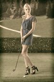 Sexy Blonde Girl Pays Golf, Looks At Left In A Vintage Style