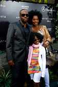 NEW YORK - MAY 29: Wyclef Jean, wife Claudenette and daughter Angelina Claudinelle attend the premie