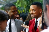 NEW YORK - MAY 29: Actor Will Smith (R) speaks to TV personality A.J. Calloway at the premiere of