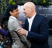 NEW YORK - MAY 29: Actor Bruce Willis (R) and M. Night Shyamalan attend the premiere of