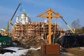 Orthodox cross on the construction of a new temple