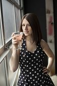 Beautiful Young Woman Drinking A Pink Martini
