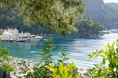Yachts At The Pier And Beach On Mediterranean Turkish Resort, Fethiye, Turkey