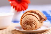 stock photo of continental food  - Continental breakfast with croisant on white plate - JPG