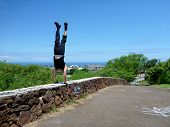 Man Handstands On Lava Rock Wall In Kaimuki