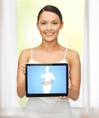 beautiful woman holding tablet pc with dieting application