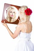 Blond Woman Looking In Mirror