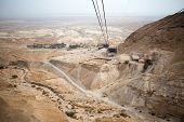 image of masada  - View of the Dead Sea and the cable car to the Masada fortress Israel - JPG