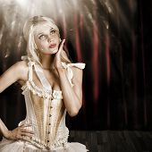 Cabaret Showgirl On Smoky Theater Stage