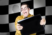 stock photo of pushy  - Overexcitable technology sales man selling laptop computers with winning deals - JPG