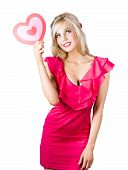 Isolated Blond Girl Holding Love Heart Sign