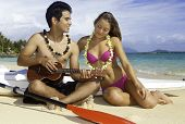 Couple On Beach With Ukulele
