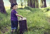 Little kid with big suitcase