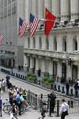 NEW YORK - MAY 30: A Chinese flag flies outside the New York Stock exchange on May 30, 2013 in New York City. The Exchange building was built in 1903.