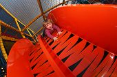 Little girl on a big slide
