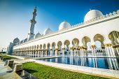 Sheikh Zayed Mosque in Middle East United Arab Emirates with reflection on water.