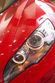 MUNICH, GERMANY - JUNE 17, 2012: Closeup View Of Shiny Bright Car's Headlights Of BMW X6 in BMW Muse
