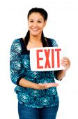 Beautiful Woman Holding Exit Sign