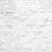 High resolution concept or conceptual old vintage white brick wall background pattern.A textured surface of aged brickwork
