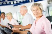 Older People Exercising In The Gym