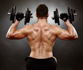 Athletic Young Man Working With Heavy Dumbbells