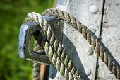 image of eyeleteer  - A detailed close up macro photo of a the eyelet on a boat with rope tied to it - JPG