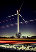 Wind Turbine At Night With Stary Sky And Light Trails