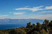 Sea Panorama With Blue Mountains