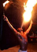 picture of breather  - Circus fire-eater blowing a large flame from his mouth