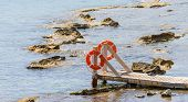 Wooden Bridge Juts Out Into The Expanse Of The Sea
