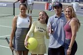 FLUSHING - AUGUST 28: Britney Spears (C) smiles with Carson Daly and tennis players Alexandra Stevenson (L) and Mary Pierce (R) during Kid's Day in Arthur Ashe Stadium August 28, 1999 in Flushing NY.